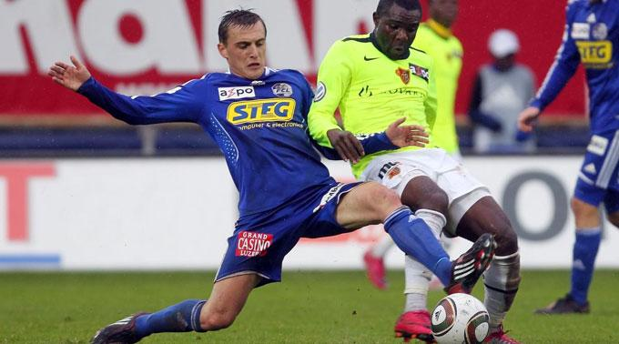 Luzerns Burim Kukeli gegen Basels Fwayo Tembo.